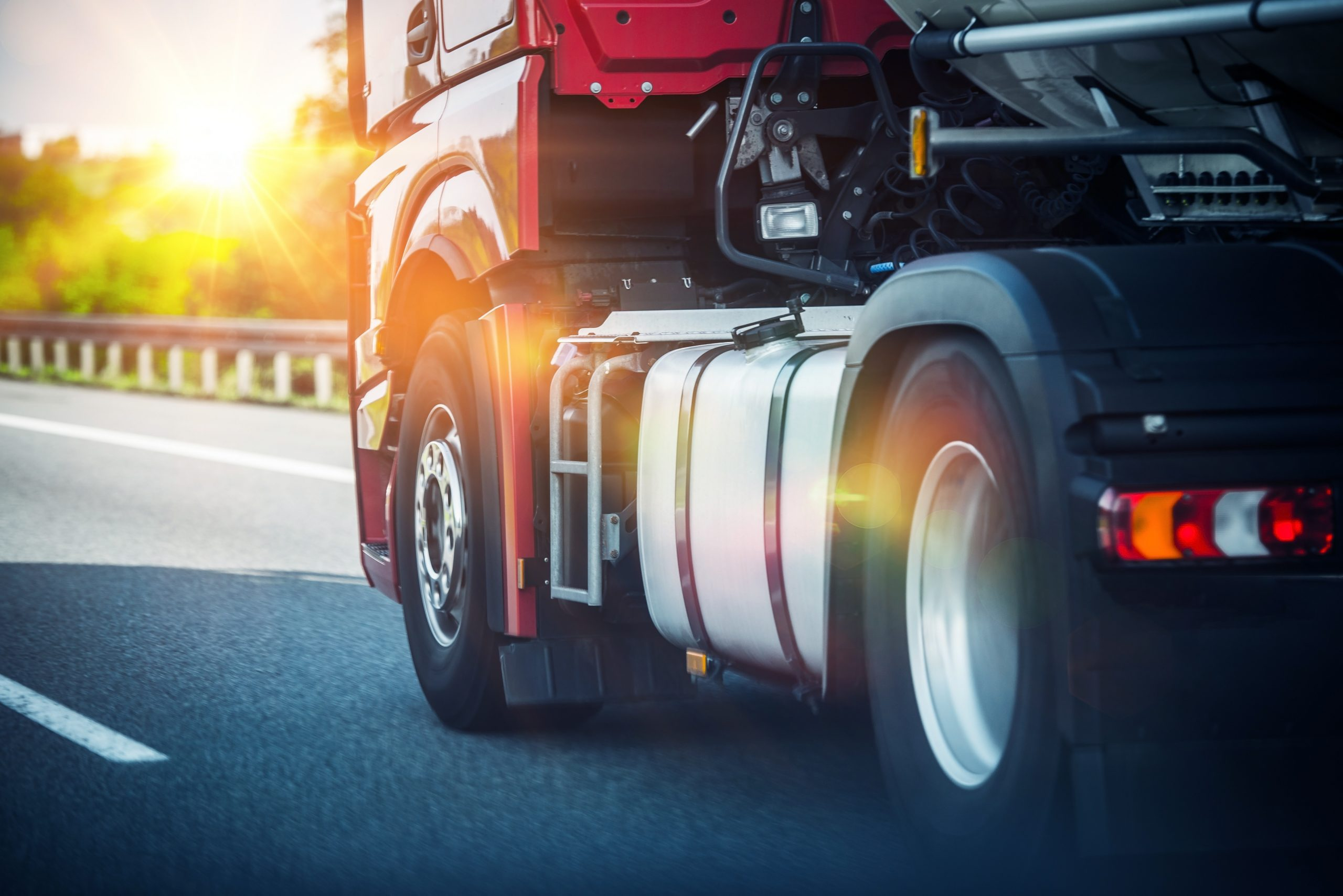 Picture of red commercial truck on highway